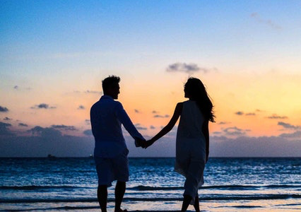 Couple on the beach at sunset